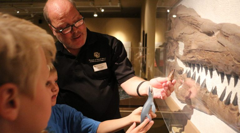Jim Hakala from the CU Museum sharing fossils with students