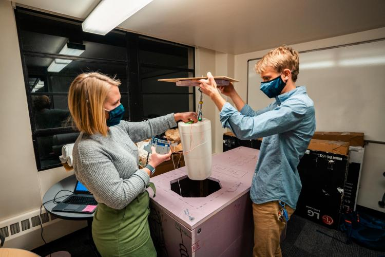 Evan Kirk and Claire Meyer demonstrate how thermal testing for the PortaVax device is set up.