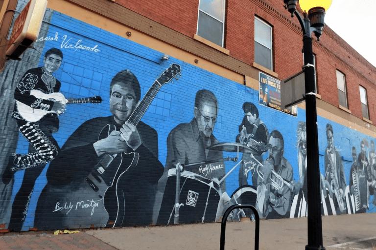 """""""Pueblo Musicians"""" by Anthony Armijo on the wall of the Klamm Shell in Pueblo, Colorado."""
